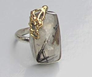 Rutilated quartz ring silver and gold