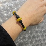 yellow and black bracelet