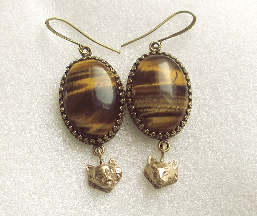 Tigers eye earrings, bronze lions
