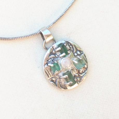 Raw emerald cross pendant