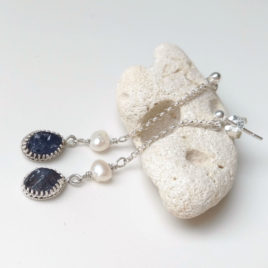 raw iolite dangles in sterling silver, on a chain, with white pearl