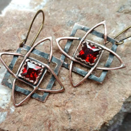 Copper Star of Svarog earrings, red garnet