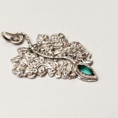Fine silver fern leaf pendant with genuine zambian emerald