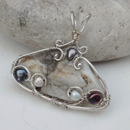 Large triangle belomorite pendant, silver wire, white and peacock pearls