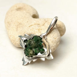 Raw tsavorite green garnet pendant in sterling silver